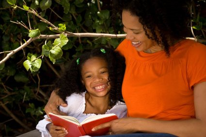 Mother and Daughter read a book outside